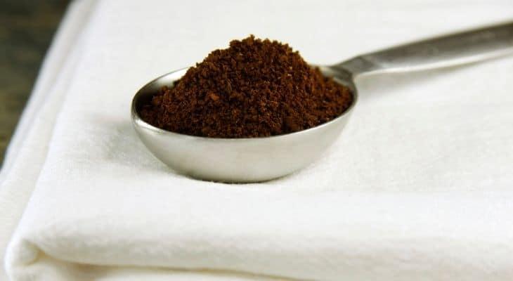 adding coffee grounds